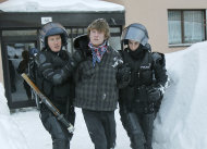Swiss riot police officers arrest a demonstrator during a demonstration against the World Economic Forum in Davos, Switzerland, Saturday, Jan. 28, 2012. (AP Photo/Michel Euler)