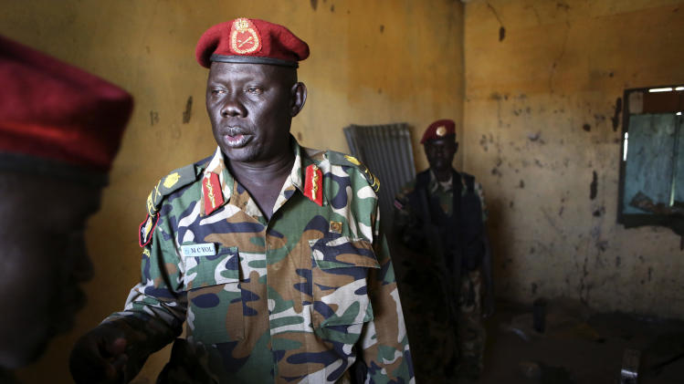SPLA Major General Marial Chanuong Yol visits an ammunition storage room which was attacked by rebel soldiers last week, in Juba