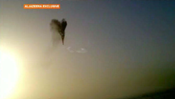 In this image taken from amateur video provided by Al-Jazeera, a hot air balloon over Luxor, Egypt bursts before plummeting about 1,000 feet to earth on Tuesday, Feb. 26, 2013. Nineteen people were killed in what appeared to be the deadliest hot air ballooning accident on record. A British tourist and the Egyptian pilot, who was badly burned, were the sole survivors. (AP Photo/Al-Jazeera) MANDATORY CREDIT: AL-JAZEERA