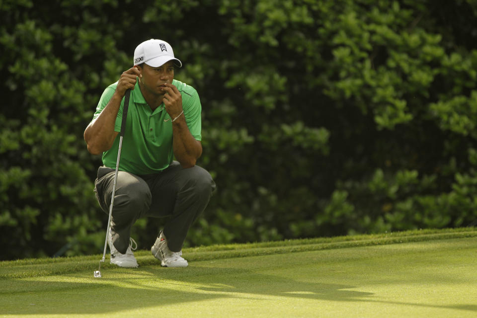 Tiger Woods lines up a putt on the 12th hole during the second round of the Wells Fargo Championship golf tournament at Quail Hollow Club in Charlotte, N.C., Friday, May 4, 2012. (AP Photo/Chuck Burton)