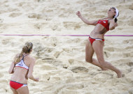 United States Kerri Walsh Jennings, left, and Misty May-Treanor, celebrate after defeating April Ross and Jennifer Kessy in a women&#39;s gold medal beach volleyball match at the 2012 Summer Olympics, London, Wednesday, Aug. 8, 2012. (AP Photo/Jae C. Hong)