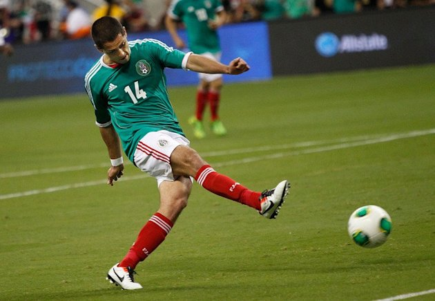 Javier Hernandez scores for Mexico against Nigeria in Houston, Texas, on May 31, 2013