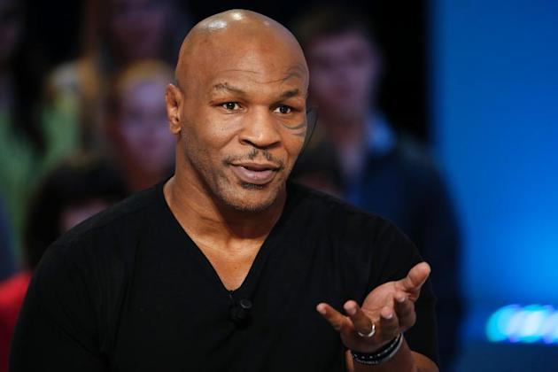 "US Former heavyweight boxing champion Mike Tyson appears on the TV show ""Le Grand Journal"" on the French television channel Canal Plus on December 9, 2013 in Paris"
