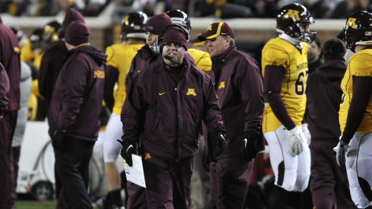 Minnesota head coach Jerry Kill, center, walks along the sideline during the fourth quarter against Illinois in an NCAA college football game on Saturday, Nov. 26, 2011, in Minneapolis. Minnesota won 27-7. (AP Photo/Tom Olmscheid)