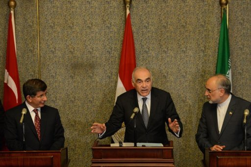 Egyptian Foreign Minister Mohammed Kamel Amr (centre) is flanked by Iranian counterpart Ali Akbar Salehi (right) and Turkish Foreign Minister Ahmet Davutoglu during a joint press conference in Cairo. The foreign ministers of the regional &quot;contact group&quot; on Syria agreed in Cairo to hold more talks in New York this month, Egypt&#39;s official MENA news agency reported on Tuesday
