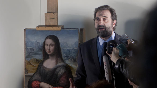 Miguel Falomir, director of Italian painting at the Prado Museum speaks to reporters next to a copy of Leonardo da Vinci's Mona Lisa that was painted at the same time as the original in the same studio is displayed at the Prado Museum in Madrid Wednesday Feb. 1, 2012. Spain's Prado Museum says the copy it has of Leonardo da Vinci's Mona Lisa was painted at the same time as the original perhaps making it the earliest replica of the masterpiece. A museum spokeswoman said the work was painted side by side with the 16th century original that hangs in the Louvre in Paris and was done by one of Leonard's key students. (AP Photo/Paul White)