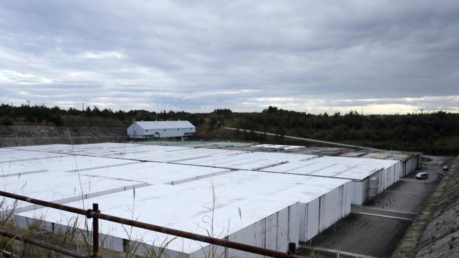 "This Nov. 8, 2012 photo shows the low-level radioactive waste disposal center, a part of the Rokkasho spent nuclear fuel reprocessing plant facilities, run by Japan Nuclear Fuel Ltd., in Rokkasho village in Aomori Prefecture, northern Japan. By hosting a high-tech facility that would convert spent fuel into a plutonium-uranium mix designed for the next generation of reactors, Rokkasho was supposed to provide fuel while minimizing nuclear waste storage problems. Those ambitions are falling apart because years of attempts to build a ""fast breeder"" reactor, which would use the reprocessed fuel, appear to be ending in failure.  (AP Photo/Koji Sasahara)"