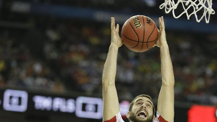 Louisville's Luke Hancock (11) shoots over Wichita State's Malcolm Armstead (2) during the second half of the NCAA Final Four tournament college basketball semifinal game Saturday, April 6, 2013, in Atlanta. (AP Photo/Charlie Neibergall)