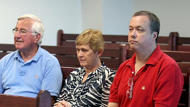 Mark Kerrigan, brother of ice skater Nancy Kerrigan, sits with his mother, Brenda Kerrigan, center, and an unidentified family friend, left, during a hearing at Middlesex Superior Court  in Woburn, Mass., Wednesday, Aug. 8, 2012.  A judge denied Kerrigan's request to return to prison, to serve the last four months of his 2 1/2-year sentence for assault and battery in connection with his father's 2010 death, rather than comply with conditions of his probation.   (AP Photo/Boston Herald, Angela Rowlings, Pool)