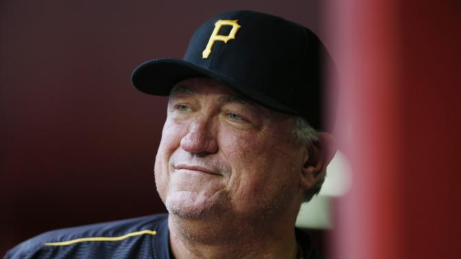 Pittsburgh Pirates' Clint Hurdle smiles as he paces in the dugout prior to a baseball game against the Arizona Diamondbacks Saturday, April 25, 2015, in Phoenix. (AP Photo/Ross D. Franklin)
