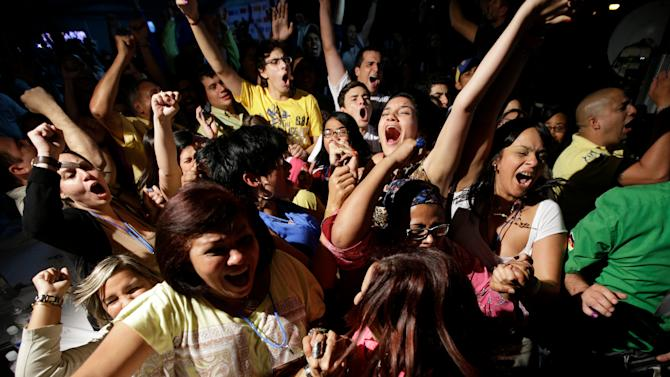 Supporters of re-elected Miranda State's Gov. Henrique Capriles celebrate after wining  in Caracas, Venezuela, Sunday, Dec. 16, 2012. Capriles lost to Chavez in the country's October election, and his re-election Sunday will allow him to cement his position as Venezuela's dominant opposition leader, even as other opposition candidates floundered.(AP Photo/Fernando Llano)