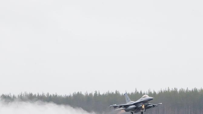 An F-16CM fighter jet from the U.S. 510th Fighter Squadron takes off during the Arctic Challenge Exercise, at Kallax Airport, Sweden