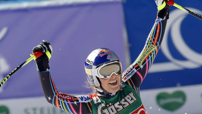 Lindsey Vonn, of the United States, celebrates after winning an alpine ski, women's World Cup downhill event, in Schladming, Austria, Wednesday, March 14, 2012. Vonn won the race and also clinched the women's World Cup downhill discipline title. (AP Photo/Armando Trovati)