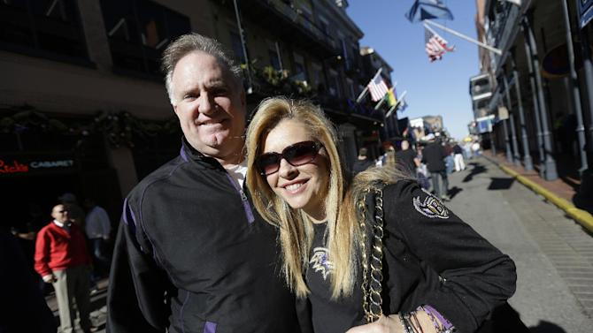 "In this Friday, Feb. 1, 2013 photo, Sean and Leigh Anne Tuohy, adoptive parents of Baltimore Ravens starting offensive lineman Michael Oher, stand on a street in New Orleans. They were depicted in the move ""The Blind Side"" and will be attending Sunday's NFL football Super Bowl between the Ravens and the San Francisco 49ers. (AP Photo/Gerald Herbert)"