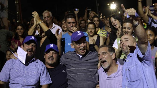 """The so-called """"Cuban Five"""" sing during Cuban musician Silvio Rodriguez's concert in Havana"""