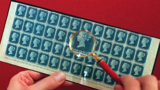 FILE - In this Nov. 3, 1998 file photo, a block of 48 mint condition 1840 Twopenny Blues stamps, which bear the image of Britain's Queen Victoria, are seen in London. Britain's business minister Ed Davey says Sunday, Jan. 9, 2011, he will guarantee that the monarch's head will appear on British postage stamps even if Royal Mail is sold to a foreign buyer.  (AP Photo/Steve Reigate, file)