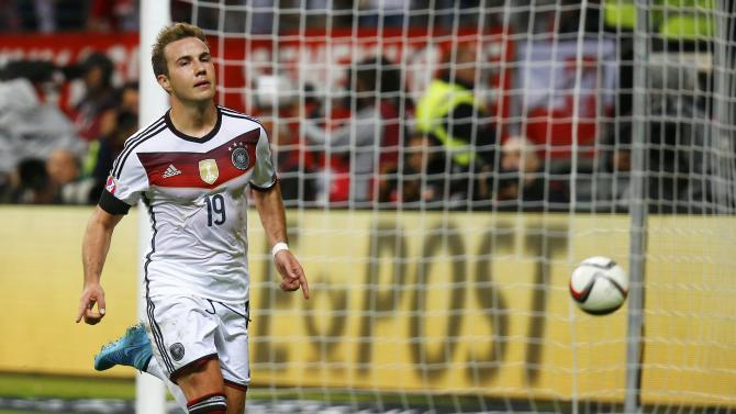 Germany's Goetze celebrates after he scored a goal against Poland during their Euro 2016 qualification match in Frankfurt