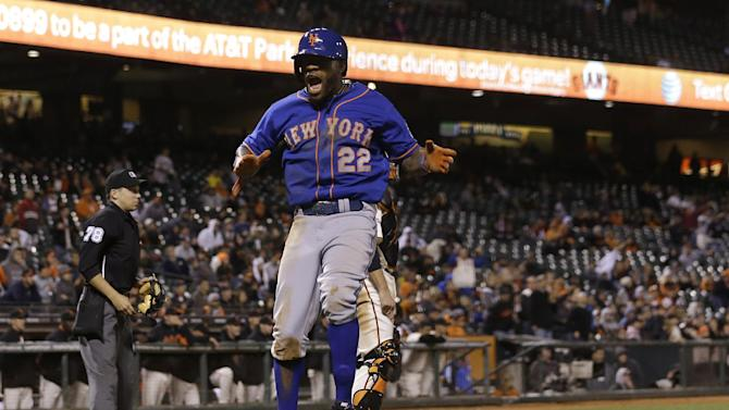 New York Mets' Eric Young Jr. (22) celebrates after scoring against the San Francisco Giants during the sixteenth inning of a baseball game in San Francisco, Tuesday, July 9, 2013. (AP Photo/Jeff Chiu)