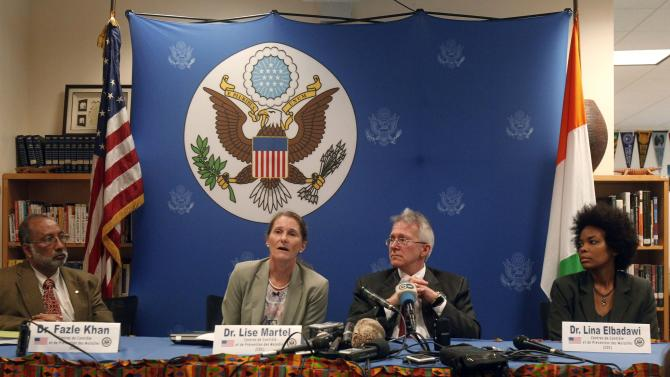 Dr. Martel, a member of a U.S. experts delegation, speaks as she sits next to McCulley, U.S. ambassador to Ivory Coast, during a news conference in Abidjan