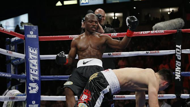 Ruslan Provodnikov, bottom, of Russia, slips in front of Timothy Bradley in the second round of a WBO welterweight title boxing match in Carson, Calif., Saturday, March 16, 2013. Bradley won by unanimous decision after the 12th round. (AP Photo/Jae C. Hong)