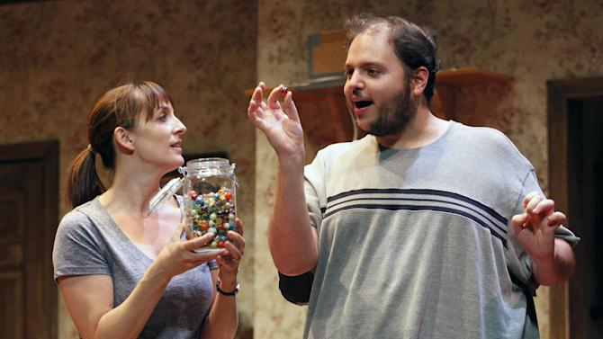 "This publicity image released by David Gersten & Associates shows Julia Murney, left, and Daniel Everidge, in a scene from ""Falling,"" performing off-Broadway at the Minetta Lane Theatre in New York.  (AP Photo/David Gersten &  Associates, Carol Rosegg)"