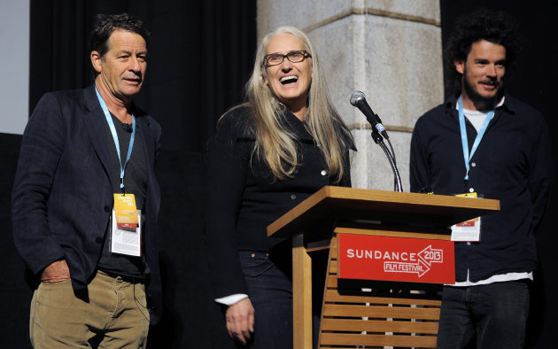 Jane Campion, center, co-writer and co-director of the Sundance Channel scripted series &quot;Top of the Lake,&quot; addresses the audience alongside co-writer Gerard Lee, left, and co-director Garth Davis at the premiere of the series at the 2013 Sundance Film Festival, Sunday, Jan. 20, 2013, in Park City, Utah. (Photo by Chris Pizzello/Invision/AP)