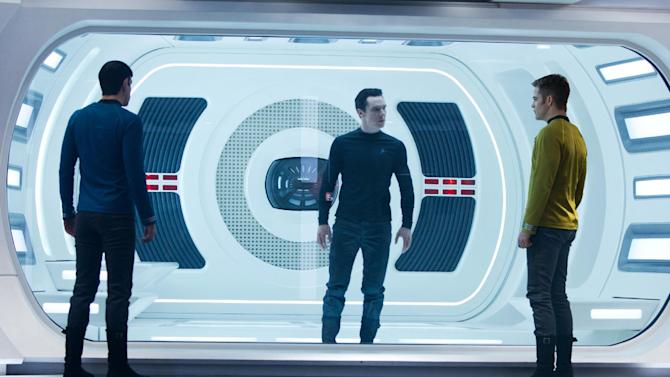 "FILE - This undated publicity film image released by Paramount Pictures shows, from left, Zachary Quinto, as Spock, Benedict Cumberbatch as John Harrison, and Chris Pine as Kirk, in a scene in the film, ""Star Trek Into Darkness,"" from Paramount Pictures and Skydance Productions. ""Star Trek Into Darkness"" was one of several upcoming films to receive spotlight treatment with an ad that aired during Super Bowl XLVII on Sunday, Feb. 3, 2013. (AP Photo/Paramount Pictures, Zade Rosenthal, File)"
