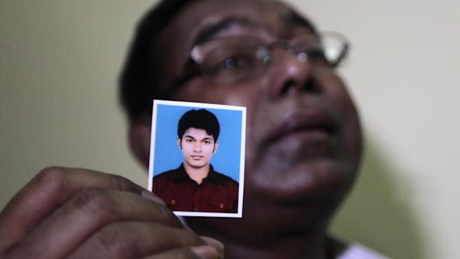 Bangladeshi Quazi Ahsanullah displays a photograph of his son Quazi Mohammad Rezwanul Ahsan Nafis as he weeps in his home in the Jatrabari neighborhood in north Dhaka, Bangladesh, Thursday, Oct. 18, 2012. The FBI arrested 21-year-old Nafis on Wednesday after he tried to detonate a fake 1,000-pound (454-kilogram) car bomb, according to a criminal complaint. His family said Thursday that Nafis was incapable of such actions. (AP Photo/A.M. Ahad)
