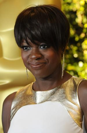 FILE - In this Nov. 12, 2011 file photo, actress Viola Davis poses at the Academy of Motion Picture Arts and Sciences' 2011 Governors Awards in Los Angeles. Davis has donated $1,000 to the Adams Memorial Library in Central Falls, R.I., where she grew up. The library, which has raised $61,000 since it was shuttered in July ahead of the city's bankruptcy filing, will be open six days a week beginning Dec. 1, 2011. (AP Photo/Chris Pizzello, File)