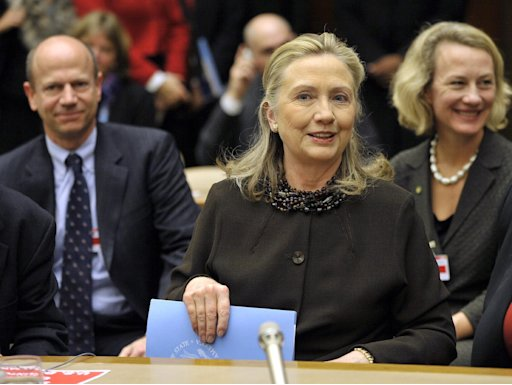 U.S. Secretary of State Clinton smiles after delivering policy statement during global conference to review Biological Weapons Convention at UN in Geneva