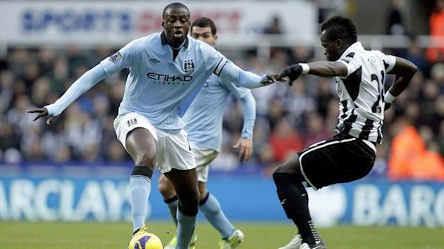 Newcastle United's Ivorian midfielder, Cheick Tiote (R) vies with Manchester City's Ivorian midfielder, Yaya Toure (AFP)
