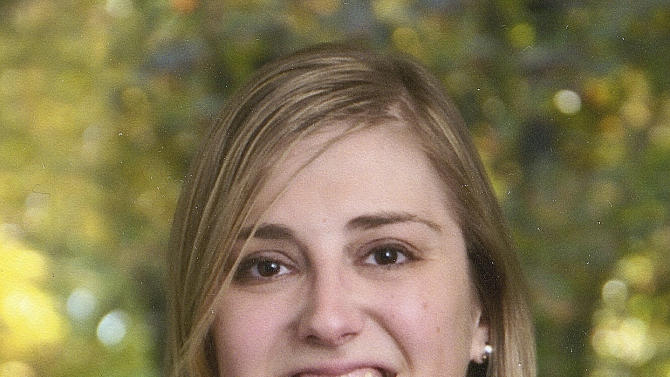 FILE - This 2012 file photo provided by the Rosseau family shows Lauren Rousseau. Rousseau was killed Friday, Dec. 14, 2012, when a gunman opened fire at Sandy Hook Elementary School, in Newtown, Conn., killing 26 children and adults at the school.  She will be one of six educators from the school honored posthumously with the 2012 Presidential Citizens Medal, presented at a White House ceremony on Feb. 15, 2013.  (AP Photo/Courtesy of Rousseau Family, File)
