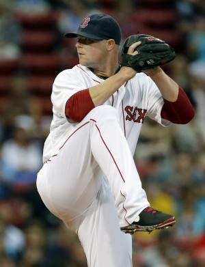 Boston Red Sox starting pitcher Jon Lester delivers to the Tampa Bay Rays during the first inning of a baseball game at Fenway Park in Boston on Tuesday, July 23, 2013. (AP Photo/Elise Amendola)