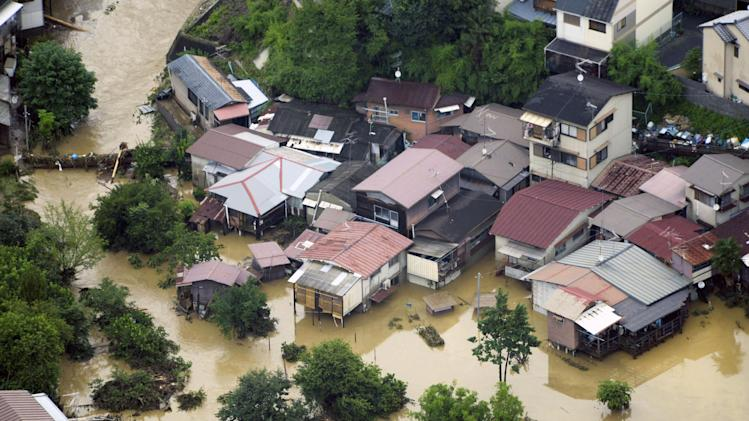 A residential area is submerged by a torrential rain overnight in Kyoto, western Japan, Sunday, July 15, 2012. Heavy rain triggered flash floods in western Japan after days of rains caused heavy damages in southern Japan which killed more than twenty. (AP Photo/Kyodo News) JAPAN OUT, MANDATORY CREDIT, NO LICENSING IN JAPAN, CHINA, HONG KONG, SOUTH KOREA AND FRANCE