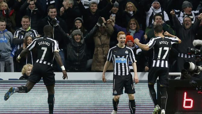 Newcastle United's Jack Colback celebrates after scoring a goal against Everton during their English Premier League soccer match at St James' Park in Newcastle