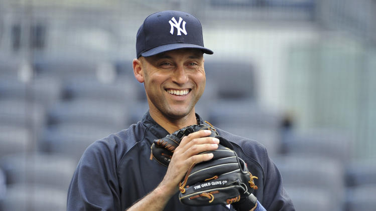 New York Yankees' Derek Jeter smiles during batting practice before the Yankees' baseball game against the Tampa Bay Rays on Thursday, July 7, 2011, at Yankee Stadium in New York. (AP Photo/Kathy Kmonicek)