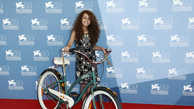 Actress Rem Abdullah poses with a bicycle, which is central to the story, during the photo call of the movie 'Wadjda' at the 69th edition of the Venice Film Festival in Venice, Italy, Friday, Aug. 31, 2012. (AP Photo/Joel Ryan)