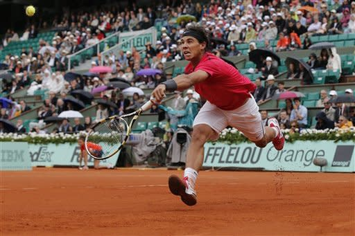 Nadal improves to 50-1 at French Open; Ferrer next