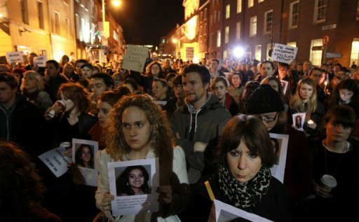 <p>Protestors hold pictures of Savita Halappanavar on November 14, 2012, who was allegedly refused an abortion that could have saved her life in Ireland. The country will introduce draft legislation and regulations to provide limited abortion in cases where the mother's life is at risk, the government announced.</p>