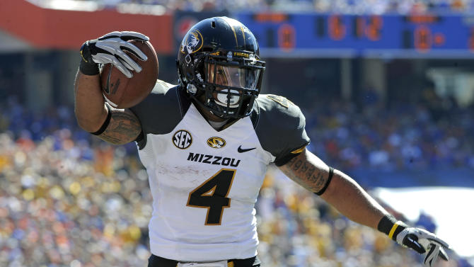 Missouri running back Kendial Lawrence runs in for a 1-yard touchdown against Florida during the first half of an NCAA college football game, Saturday, Nov. 3, 2012, in Gainesville, Fla. (AP Photo/Phil Sandlin)