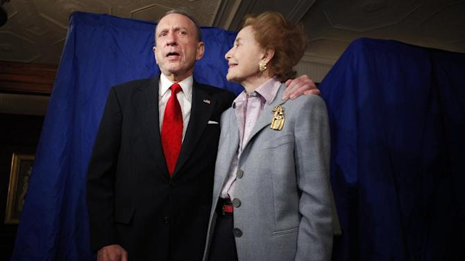 FILE - In this May 18, 2010 file photo, Sen. Arlen Specter, D-Pa., stands with his wife Joan Specter after voting, in Philadelphia.  Former U.S. Sen. Arlen Specter, longtime Senate moderate and architect of one-bullet theory in JFK death, died Sunday, Oct. 14, 2012.  He was 82. (AP Photo/Carolyn Kaster, File)