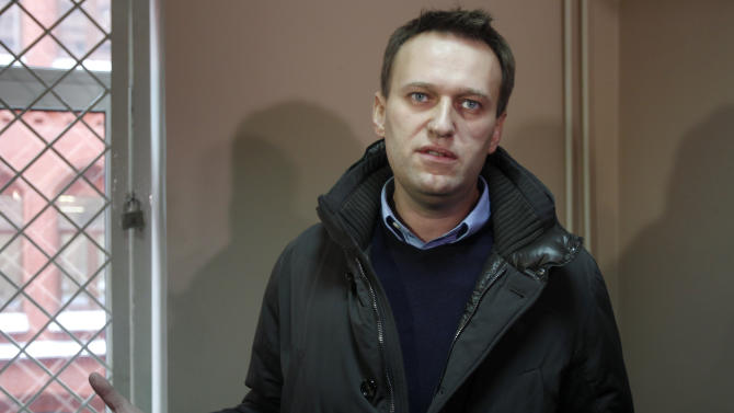 In this Thursday, March 15, 2012 file photo, opposition activist Alexei Navalny speaks to the media at a court in Moscow, Russia. Russia's leading corruption whistleblower on Friday, March 30, 2012, leveled accusations of graft at Prime Minister Vladimir Putin's close ally Igor Shuvalov. Alexei Navalny posted in his blog the scans of documents that show tens of millions of U.S. dollars transferred to the account of Shuvalov's company from firms that Navalny alleges are owned by billionaires Roman Abramovich and Alisher Usmanov.(AP Photo/Misha Japaridze, file)