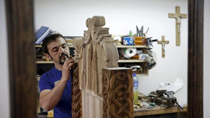 Bosnian wood carver-sculptor Edin Hajderovac works on a chair for Pope Francis, at his workshop in Zavidovici