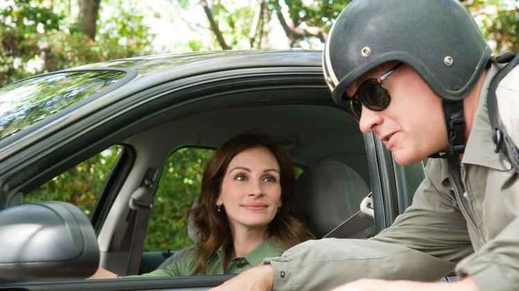 "In this film publicity image released by Universal Pictures, Julia Roberts, left, and Tom Hanks are shown in a scene from ""Larry Crowne."" (AP Photo/Universal Pictures, Bruce Talamon)"