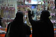 Saudi women shop at a mall in Riyadh on August 18. A Saudi columnist has triggered a furore in the ultra-conservative kingdom after he wrote on micro-blogging website Twitter that some Saudi women were working as prostitutes in Dubai