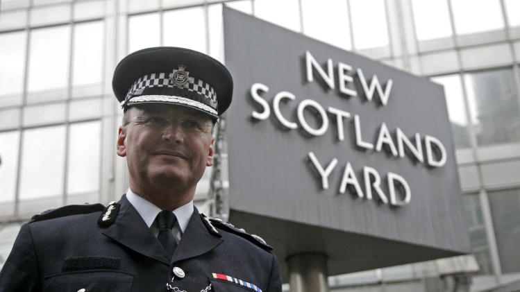 FILE - A Wednesday, Jan. 28, 2009 photo from files showing Metropolitan Police Commissioner, Sir Paul Stephenson, outside New Scotland Yard in London. London's police chief announced he had quit Sunday, July 17, 2011, over his links to a former News of the World editor caught up in the phone hacking scandal. Metropolitan Police commissioner Paul Stephenson denies wrongdoing. But he has been criticized for hiring Neil Wallis, a former News of the World executive editor arrested last week in the scandal, as a part-time PR consultant for a year until September 2010. (AP Photo/Sang Tan, File)