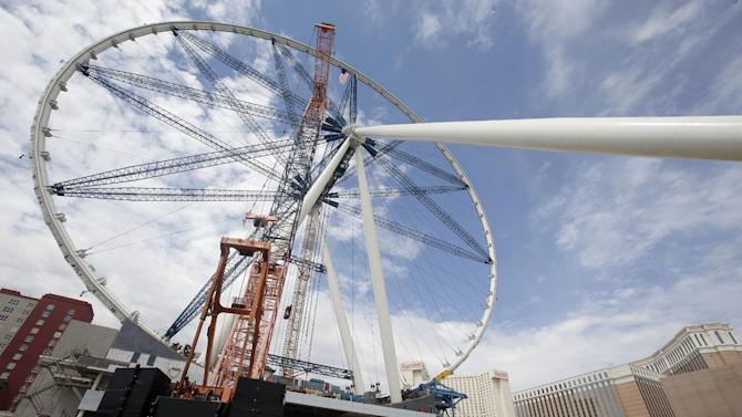 The final rim piece is added to the 55-story High Roller Ferris wheel under construction near the Las Vegas Strip on Tuesday, Sept. 10, 2013, in Las Vegas. Caesars Entertainment Corp. is building the ride expected to open early next year. (AP Photo/Isaac Brekken)