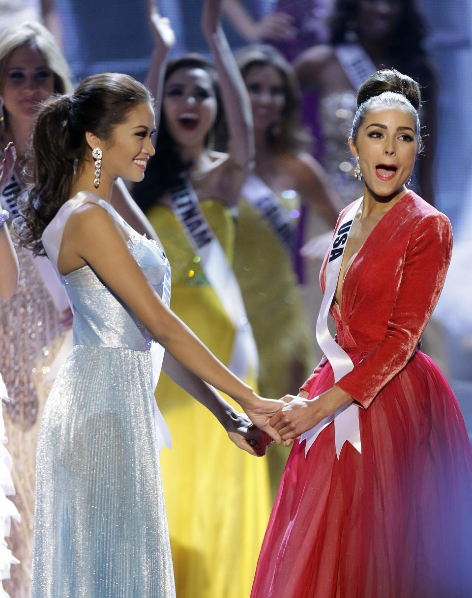 Miss USA, Olivia Culpo, right, reacts as she is announced as the new Miss Universe over first runner-up Miss Philippines, Janine Tugonon, left, during the Miss Universe competition, Wednesday, Dec. 19, 2012, in Las Vegas. (AP Photo/Julie Jacobson)