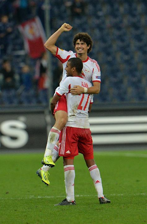 Salzburg's Alan ,  from left, and Andre Ramalho celebrate after scoring  during the Europa League group C soccer match  between Red  Bull Salzburg and Standard  Liege  in Salzburg, Austria, Thursday,