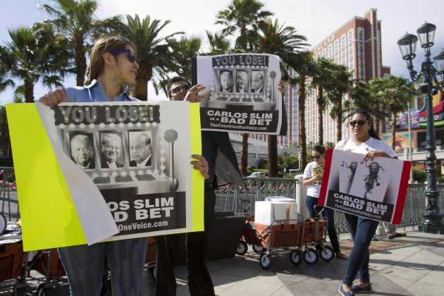 Lobbyists protest against Mexican businessman Carlos Slim in Las Vegas